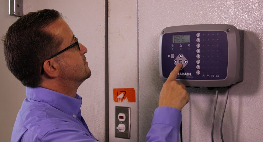 Mechanical contractor testing MGS-408 Gas Detection Controller outside of walk-in freezer.