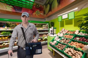 Refrigeration contractor performing a leak inspection in a supermarket.