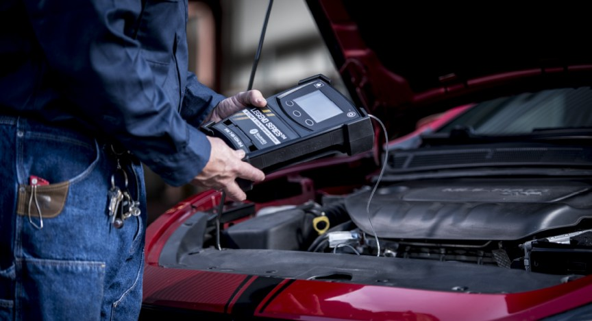 Mechanic using Neutronics Legend refrigerant analyzer to service a vehicle equipped with R-1234yf.