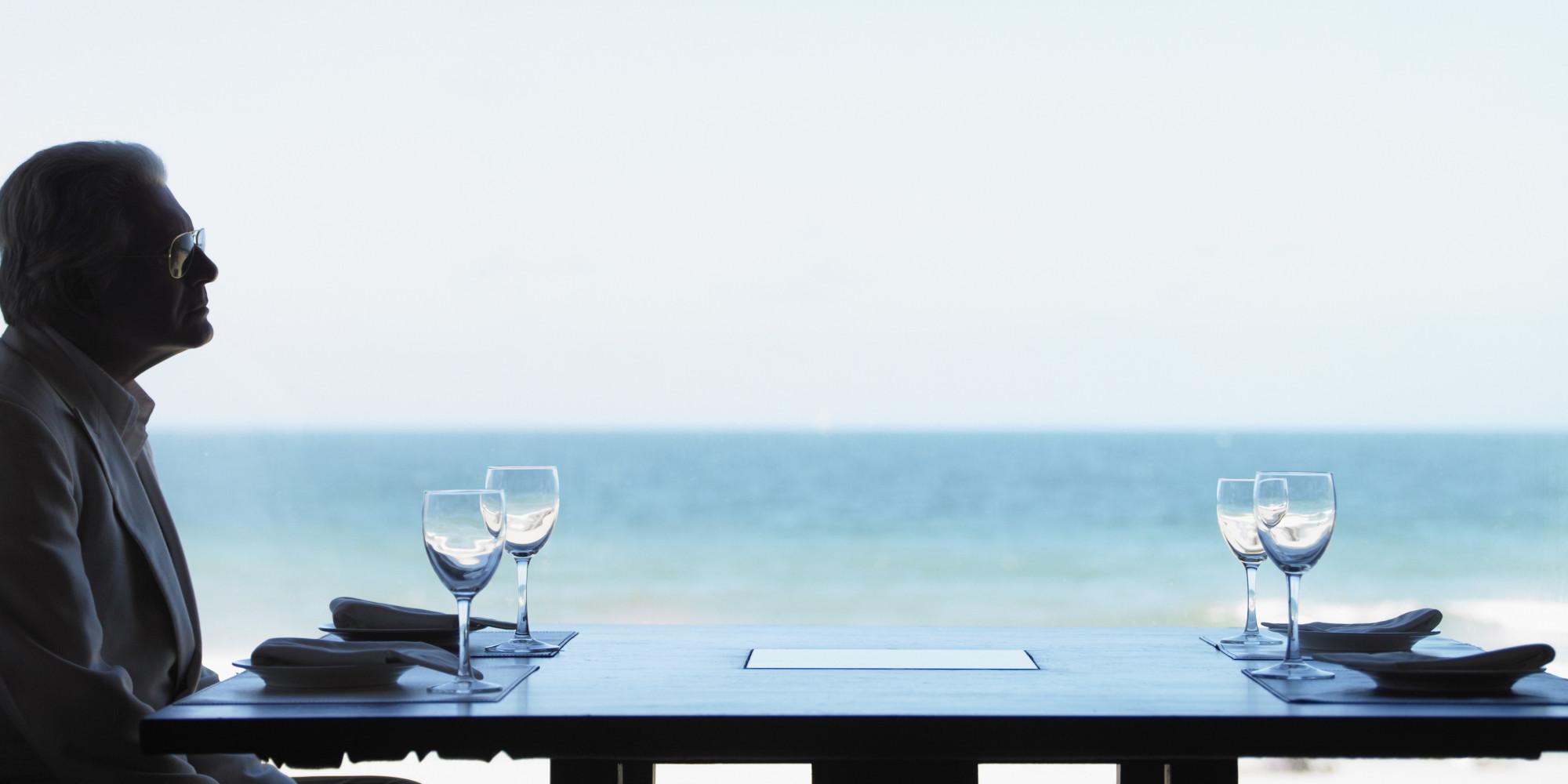 Senior Man Waiting at Ocean View Table