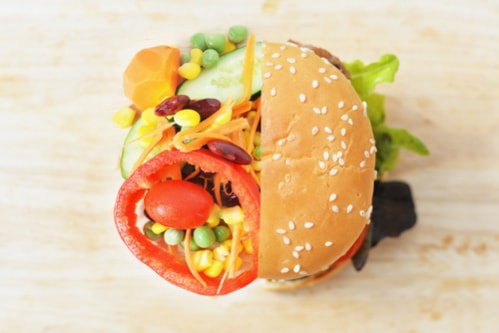 Burger and vegetables comparison health food concept