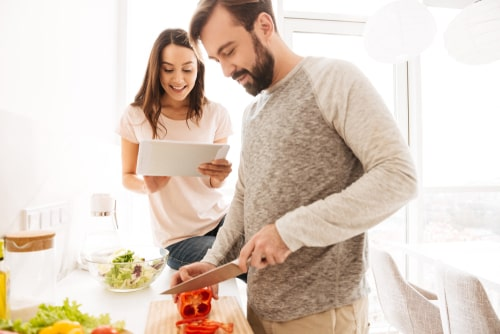 Man and woman preparing healthy meals at home