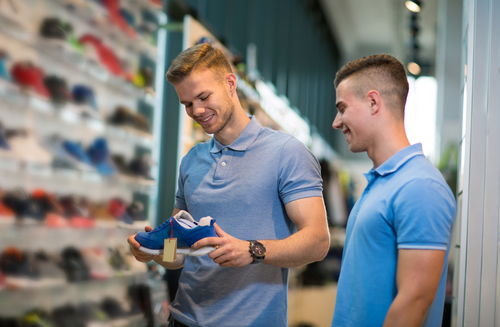 Man getting walking shoes fitted
