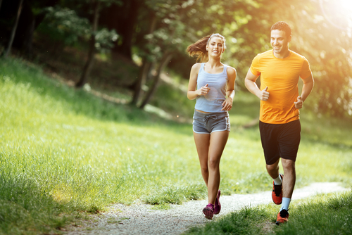 Couple jogging on a park footpath