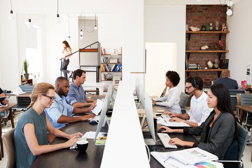 Office workers in sedentary jobs on computers