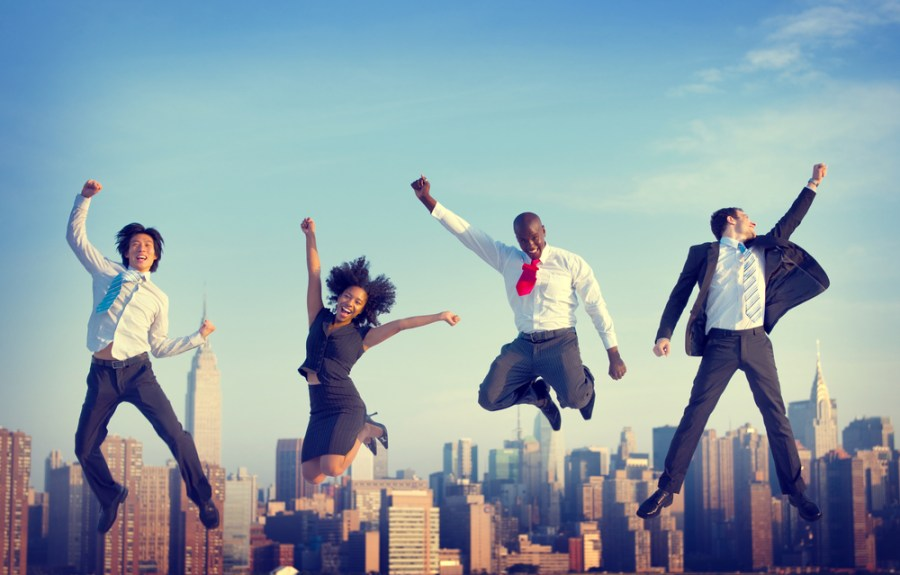 Businesspeople jumping for joy - active office concept