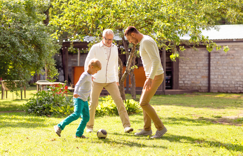 Dad and grandpa playing with kid