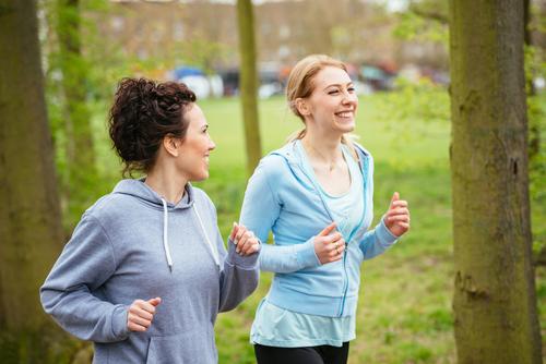 Happey women walking together in park