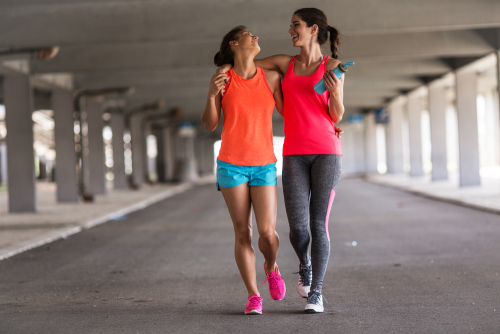 women walking together after a workout