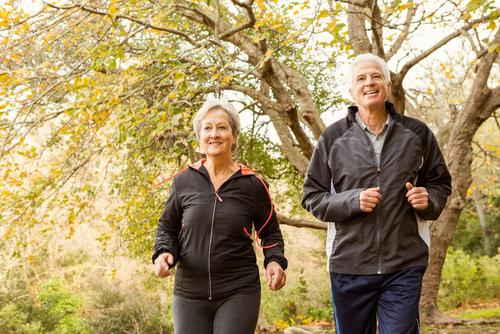 Older couple walking for fitness