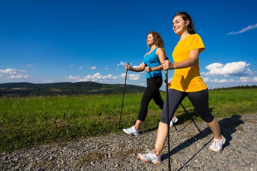 Women nordic walking in an natural setting