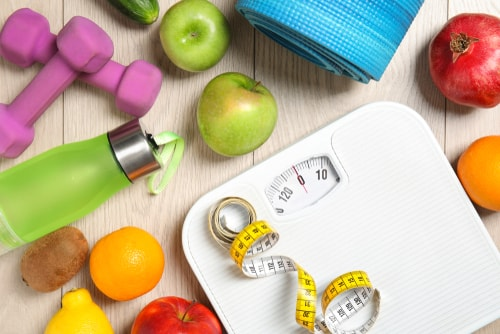 Scale with healthy foods - weight loss concept
