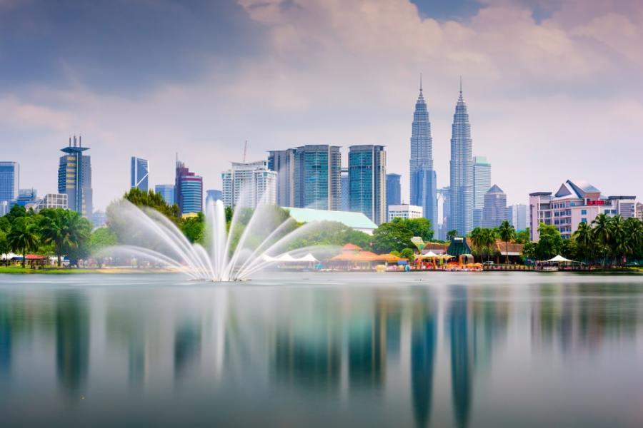 Kuala Lumpur skyline and park with fountain