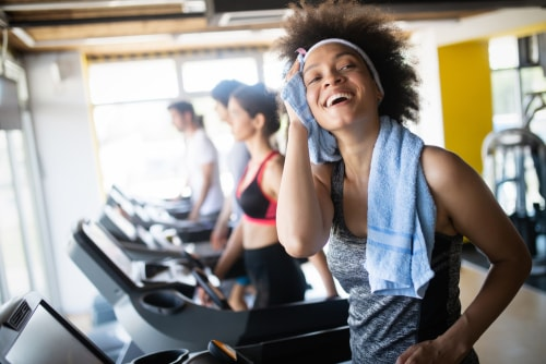 Woman sweating after treadmill cardio workout