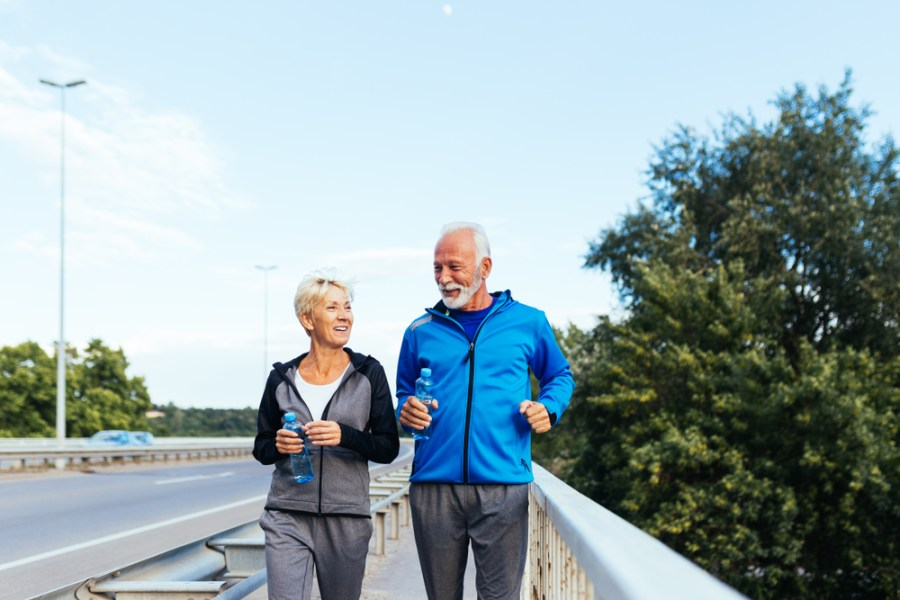 Active seniors walking on a bridge