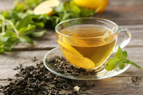 Healthy unsweetened green tea and tea leaves