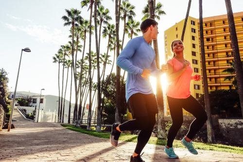 Man and woman jogging in city in morning