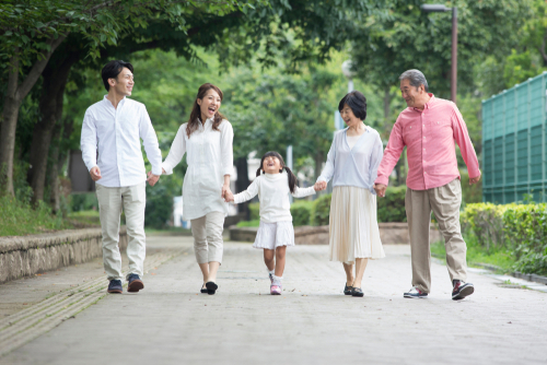 3 generations of family walking in Japan