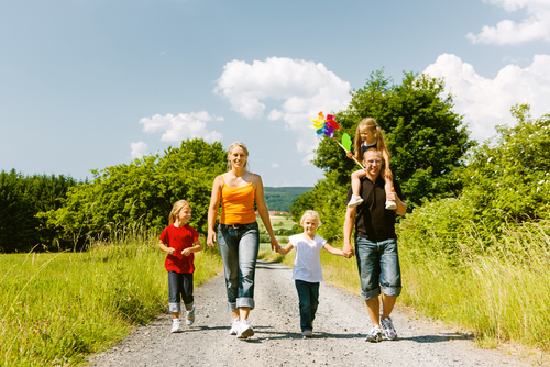 Family walking together in the countryside