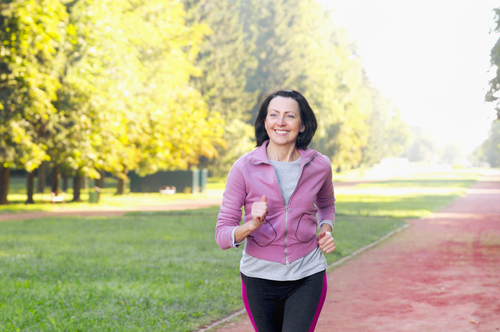 Senior woman walking for fitness in the park