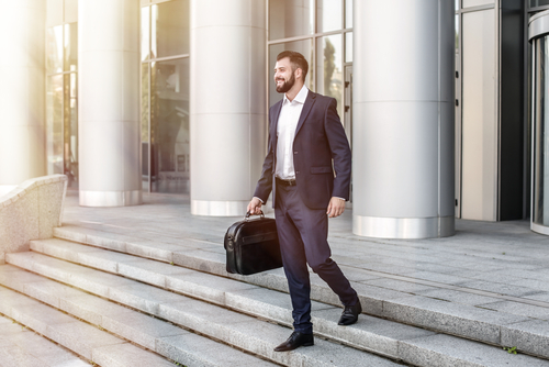 Businessman walking outside of his office