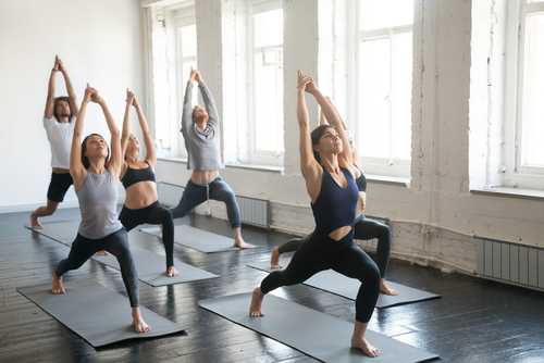 Yoga class doing intense yoga poses
