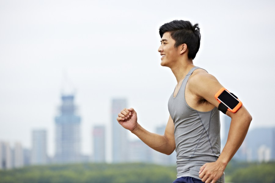 Man walking for fitness with phone armband