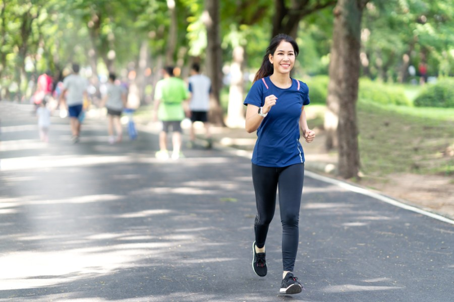 Athletic woman fitness walking in the park