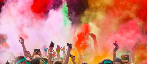 People throwing color powder in a color run