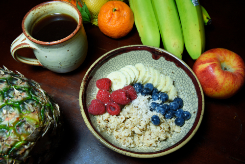 Healthy oatmeal with fruit and coffee