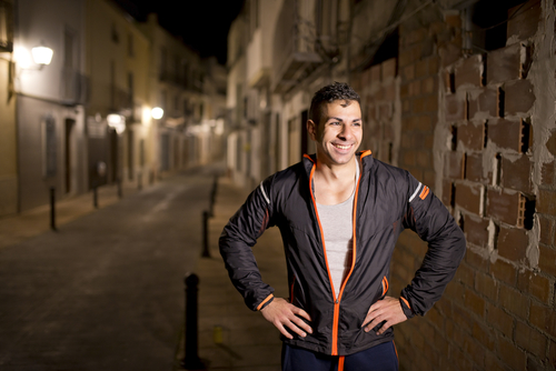 Man taking a break after a run at night