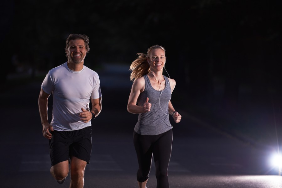 Man and woman fitness walking at night
