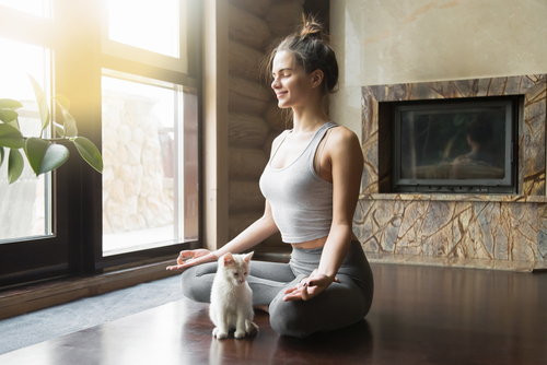 Woman doing yoga at home - rest day concept