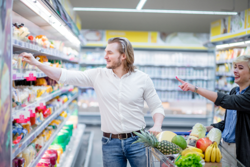Couple choosing healthy snacks at the supermarket