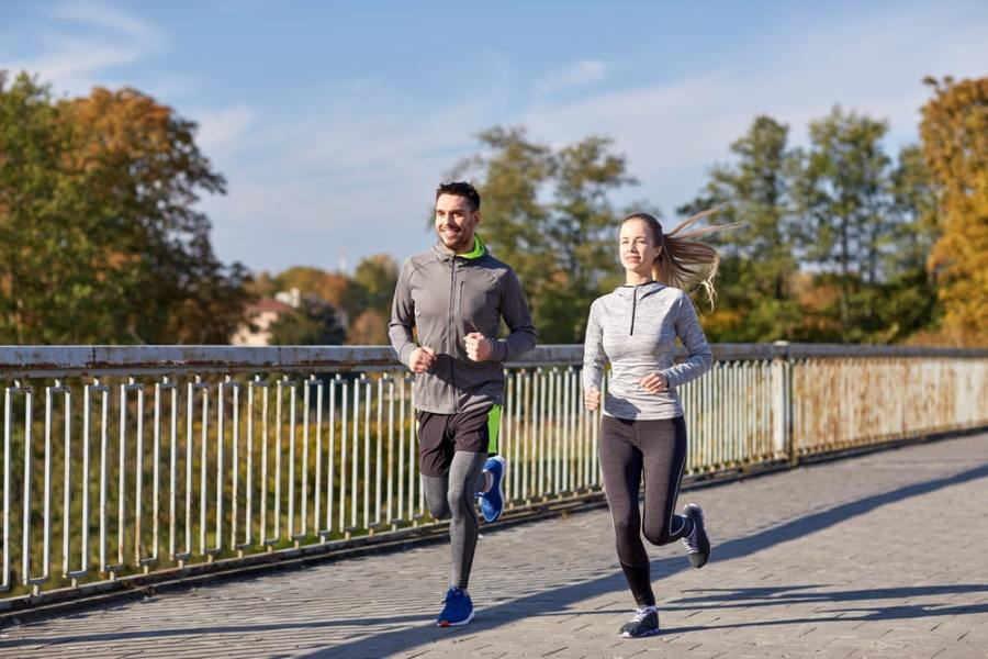 Man and woman running together for fitness