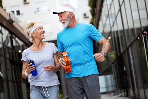 Senior couple walking or jogging for fitness