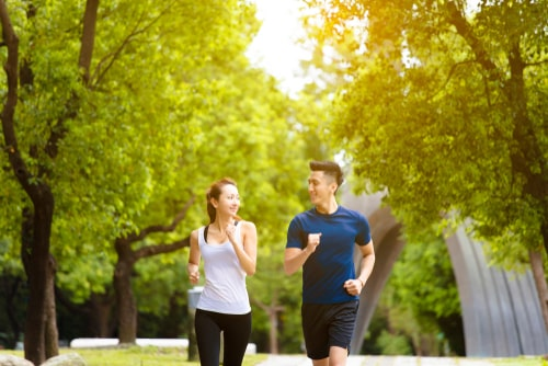 Couple walking together in the park for fitness
