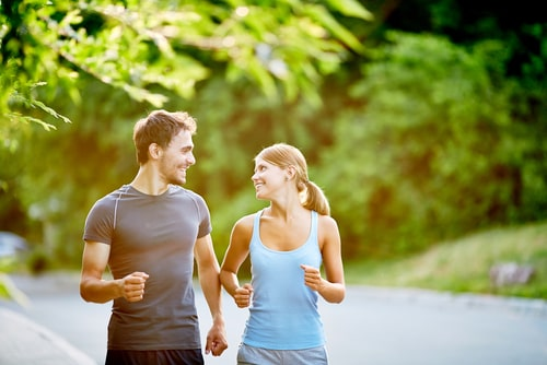 Couple fitness walking in the park in the morning