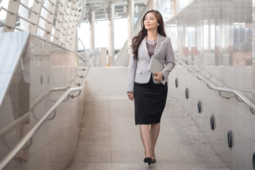 Businesswoman taking a quick walking break