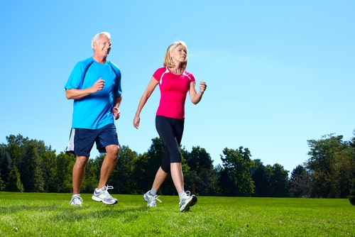 Couple fitness walking on a grassy field
