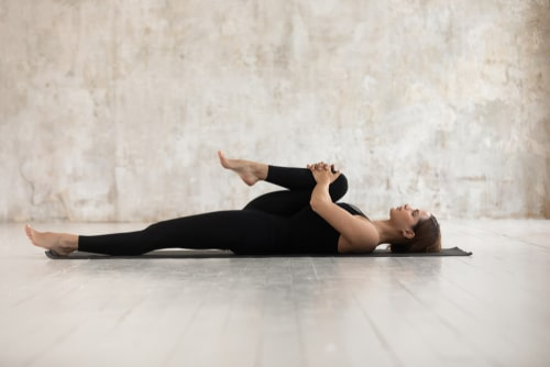 Pilates single leg stretch concept