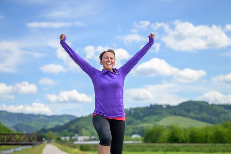 Woman celebrating achieving her fitness goals