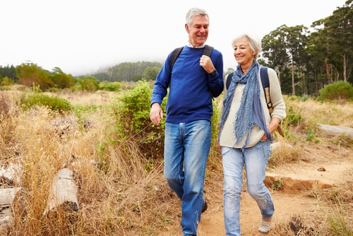 Senior couple walking in the countryside