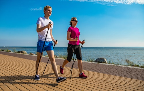 Couple doing Nordic walking by the seaside