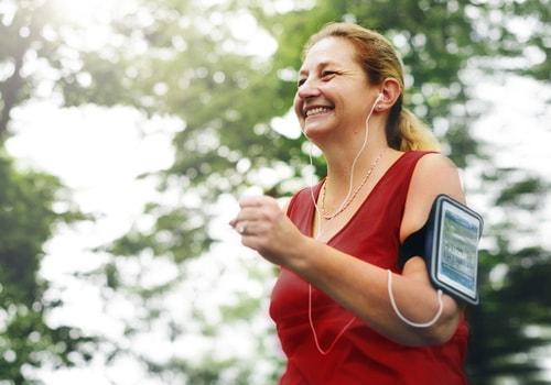 Woman fitness walking listening to headphones