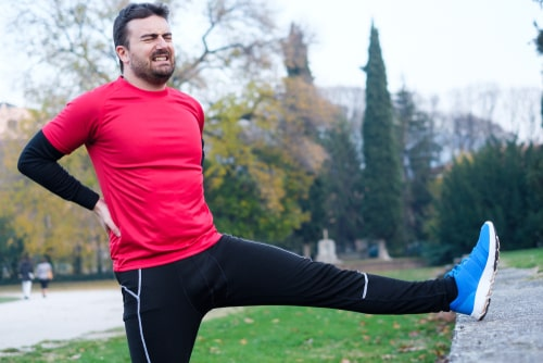 Man holding sore back after exercise