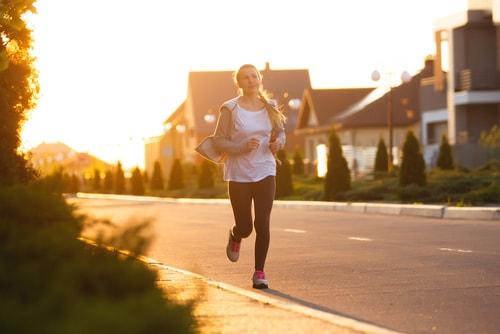 Woman running on deserted street in morning