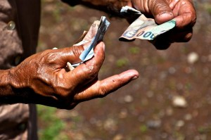 old hands exchanging money