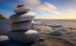cairn of rocks by the ocean