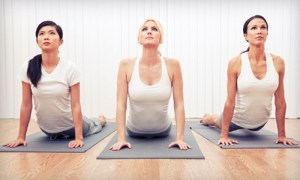 women doing updog yoga pose